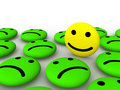 Happy smiley face among sad smileys Stock Photos
