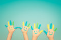 Happy smiley hands family with on against blue summer sky background Stock Image