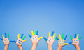 Happy smiley hands people with on against blue summer sky background Royalty Free Stock Photos