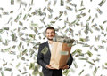 Happy and smiley man under dollar s rain businessman holding paper bag with money Royalty Free Stock Image