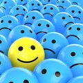 Happy smiley between sad ones Royalty Free Stock Photos