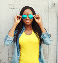 Happy smiling african woman in colorful clothes and sunglasses Royalty Free Stock Photo