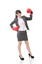 Happy smiling asian business woman with red boxing glove full length portrait isolated on the white background Stock Photos