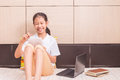 Happy smiling asian girl using tablet computer to study Royalty Free Stock Photo