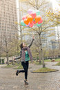 Happy smiling Asian woman holding balloons Royalty Free Stock Photo