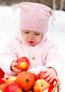 Happy smiling baby with apple in winter day park Stock Photo