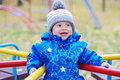 Happy smiling baby boy outdoors in autumn on playground age of year Stock Image