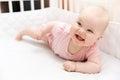 Happy smiling baby girl in crib Royalty Free Stock Photo