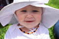 Happy smiling baby girl in white hat Royalty Free Stock Photo
