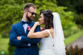 Happy, smiling beautiful bride looking at handsome groom and lea Royalty Free Stock Photo