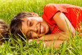 Happy smiling boy laying on the grass in park Stock Photography