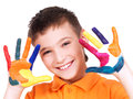 Happy smiling boy with a painted hands. Royalty Free Stock Images
