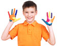 Happy smiling boy with a painted hands. Royalty Free Stock Photos