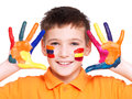 Happy smiling boy with a painted hands and face. Royalty Free Stock Photography