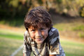 Happy smiling boy in the park near sunset Royalty Free Stock Images