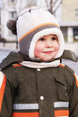 Happy smiling boy in winter clothes Royalty Free Stock Photo