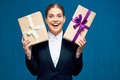 Happy smiling business woman holding gift boxes.