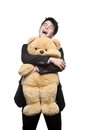 Happy smiling businessman embracing big soft toy Royalty Free Stock Images