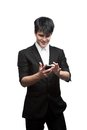 Happy smiling businessman using cell phone Royalty Free Stock Photo