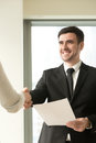 Happy smiling businessman wearing suit shaking female hand, hold Royalty Free Stock Photo