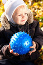 Happy smiling child with blue ball in his hands Stock Image