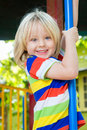 Happy, smiling child playing in a play ground Royalty Free Stock Photo