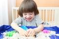 Happy Smiling Child Plays Kine...