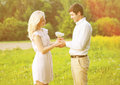 Happy smiling couple holding bouquet Royalty Free Stock Photo