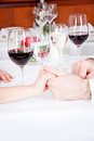 Happy smiling couple in restaurant celebrate toast champagne dinner Stock Photos