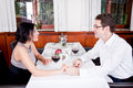 Happy smiling couple in restaurant celebrate toast champagne dinner Royalty Free Stock Image