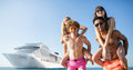 Happy smiling couples who travel by cruiseship. Concept of holiday and summertime Royalty Free Stock Photo