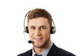 Happy smiling customer support phone operator. Royalty Free Stock Photo