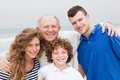Happy smiling family on beach vacation three generation holiday Royalty Free Stock Image