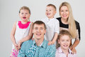 Happy smiling family of five people in the studio Royalty Free Stock Images