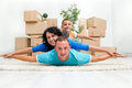 Happy smiling family moving at new home Stock Photos
