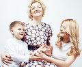 Happy smiling family together posing cheerful on white background, lifestyle people concept, mother with son and teenage Royalty Free Stock Photo