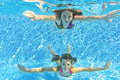 Happy smiling family underwater in swimming pool Stock Photos