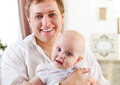 Happy smiling father with six month old baby girl indoor Royalty Free Stock Photography