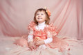 Happy smiling funny little girl looking up over drapery beauty Stock Photo