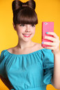 Happy smiling funny teen girl Taking Selfie Photo on Smart Phone Royalty Free Stock Photo