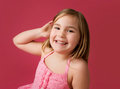 Happy smiling girl looking at the camera pink background Royalty Free Stock Images