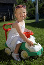 Happy smiling Girl in Toy Car Stock Image