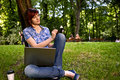 Happy smiling girl working online. Royalty Free Stock Photo
