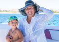 Happy smiling grandmother and grandson having fun spending time together on a beach. Little baby boy. Happy family. Positive human Royalty Free Stock Photo