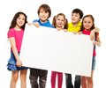 Happy smiling group of kids friends boys and girls showing blank placard board to write it on your own text isolated on white Royalty Free Stock Photo