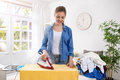 Happy and smiling housewife enjoys in ironing her clothes Royalty Free Stock Photo