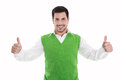 Happy smiling and isolated man in green pullover with thumbs up gesture over white background Royalty Free Stock Photography