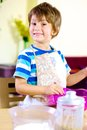 Happy smiling kid cooking at home Royalty Free Stock Image