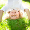 Happy smiling kid playing green grass spring park healthy lifestyle concept children s fitness Royalty Free Stock Photo