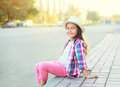Happy smiling little girl child wearing a checkered pink shirt and hat Royalty Free Stock Photo